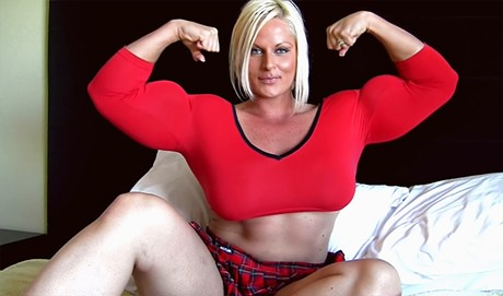 Massive Muscular Amazon Nuriye Evans flexing her biceps from wonderful katie morgan