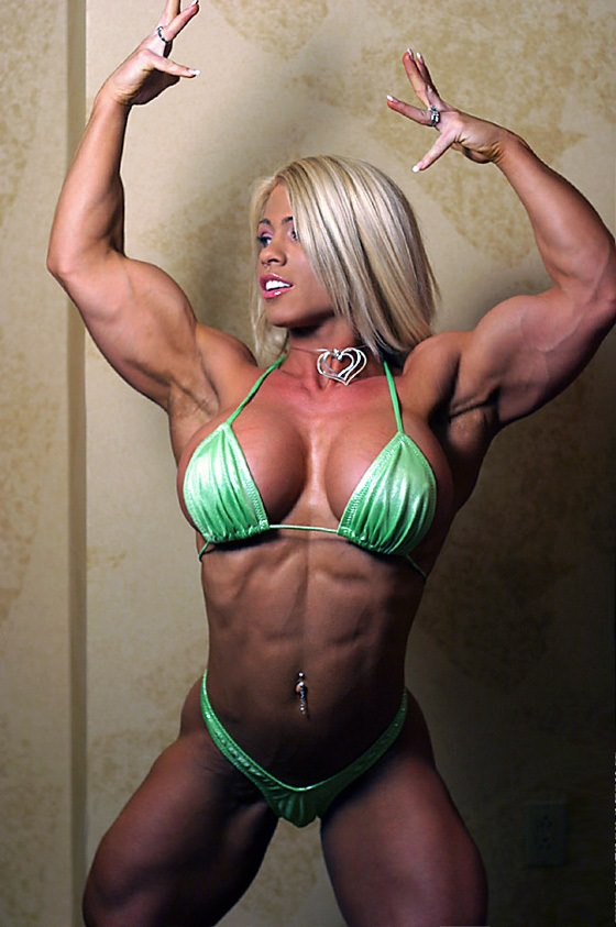 image Naked female bodybuilder masturbates her big clit
